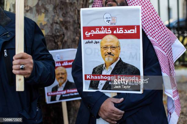 Protesters holding placards demonstrate against the killing of journalist Jamal Khashoggi outside the Saudi Arabian Embassy in London on October 26...