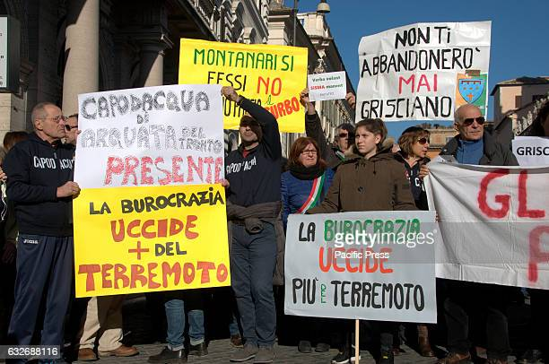 Protesters holding placards during the protest. A protest in Rome of the populations of central Italy hit by the earthquake and bad weather. The...