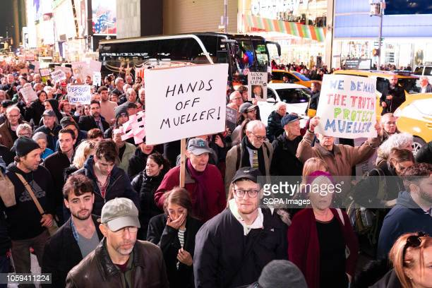Protesters holding placards during the rally Thousands took to Times Square of New York City during a rally to support Robert Mueller's investigation...