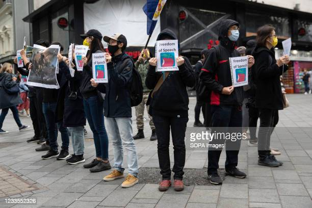 Protesters holding placards expressing their opinion, during the demonstration. Hong Kong's national security police arrested the chief editor and...