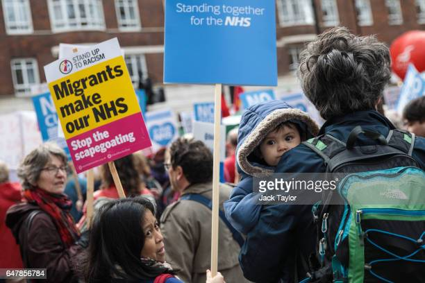 Protesters holding placards gather during a demonstration in support of the NHS in Tavistock Square on March 4 2017 in London England Thousands march...