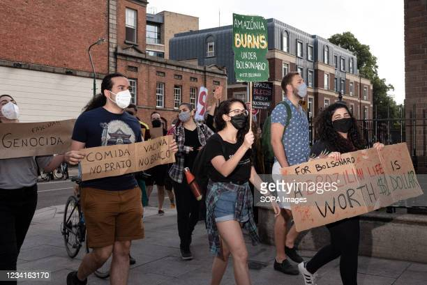 Protesters holding placards march towards the Brazilian embassy in Dublin to express their opposition to the Brazilian President Jair Bolsonaro. In...