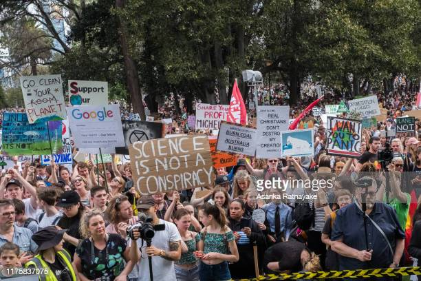 Protesters holding placards on September 20 2019 in Various Cities Australia Rallies held across Australia are part of a global mass day of protest...