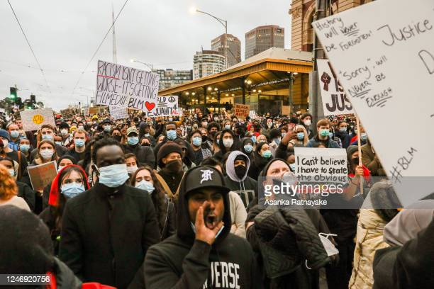 Protesters holding placards protesting on June 06, 2020 in Melbourne, Australia. Events across Australia have been organised in solidarity with...