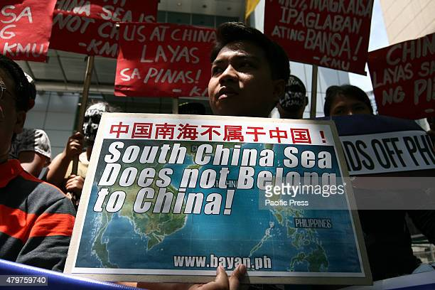 Protesters holding posters against China's incursions in the South China Sea. Labor group Kilusang Mayo Uno lead a protest march to the Chinese...