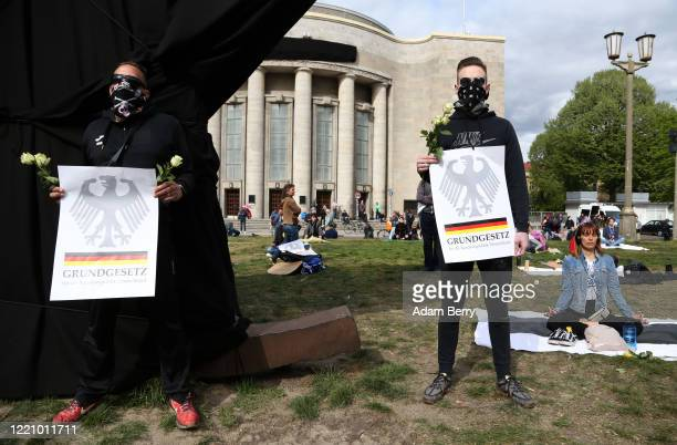 Protesters holding signs referring to the Grundgesetz, or German constitution known as the basic law, demonstrate against restrictions on public life...