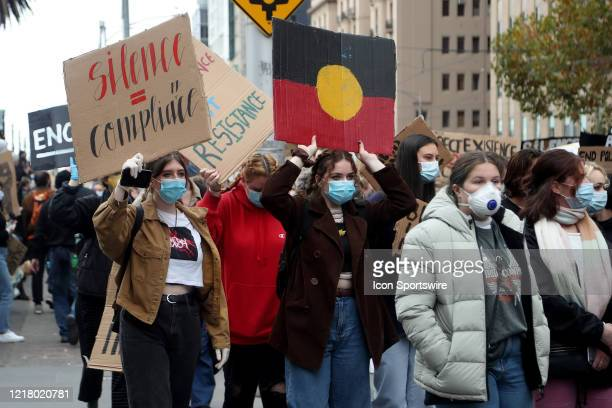 Protesters holding up signs on Bourke Street during the protest on 06 June, 2020 in Melbourne, Australia. This event was organised to rally against...
