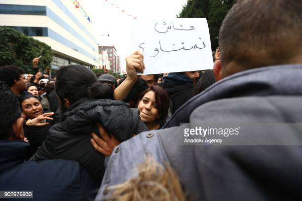 Protesters holds a placard during a demonstration against price hikes on Avenue Habib Bourguiba in front of Municipal Theatre of Tunis, Tunisia on...