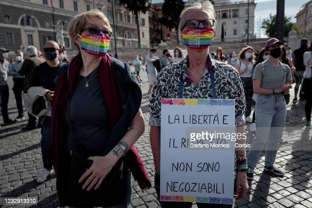 Protesters holds a sign at demonstration in favor of Zan Decree, to Piazza del Popolo, to ask the government to approve the law, blocked in the...