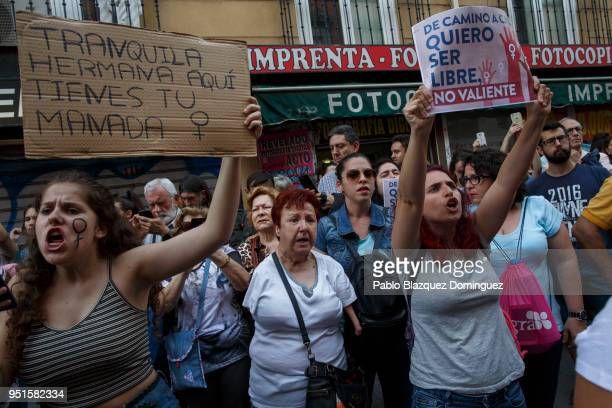 Protesters holds placards reading 'On my way home i want to be free instead of brave' during a demonstration against the verdict of the 'La Manada'...
