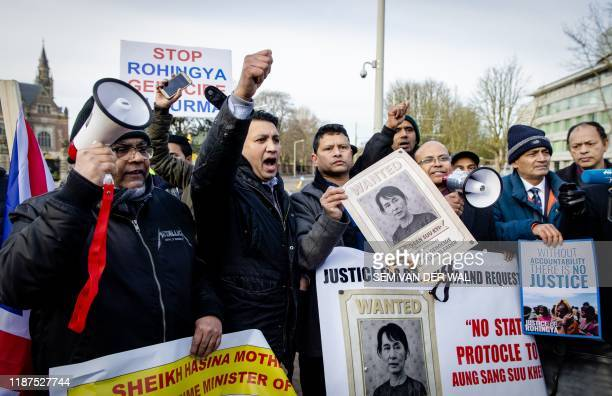 Protesters holds portraits of Myanmarese government leader Aung San Suu Kyi as they take part in a demonstration in support to the Rohingya Muslim...
