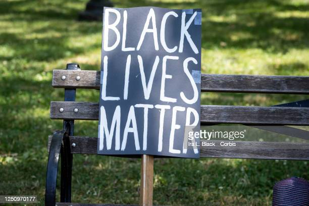 A protesters homemade sign that reads Black Lives Matter' sits on a park bench next to a hat in Cadman Plaza in Brooklyn This was part of the Unite...
