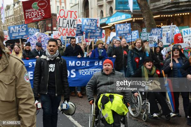 Protesters in a wheelchair seen shouting slogans during the demonstration Thousand of people marched in London in a protest called 'NHS in crisis fix...