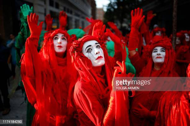 TOPSHOT Protesters in costume gather at Marble Arch in London at an opening ceremony to mark the beginning of the International Rebellion on October...