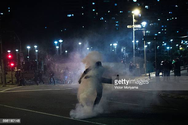 Protesters in favor of former President Dilma Rousseff clash with police during a protest march on August 31, 2016 in Sao Paulo, Brazil. Rousseff was...