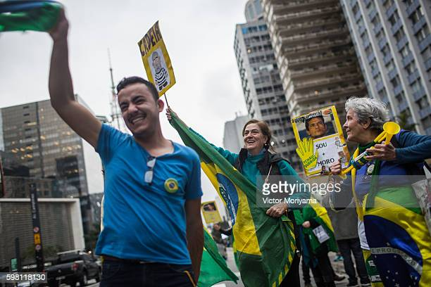 Protesters in favor of impeachment against President Dilma Rousseff celebrate the inauguration of the new President Michel Temer at Avenida Paulista...
