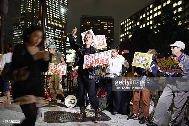 Protesters in front of the prime minister's official residence voice their opposition to the state secrets protection law on October 14 2014 in Tokyo...