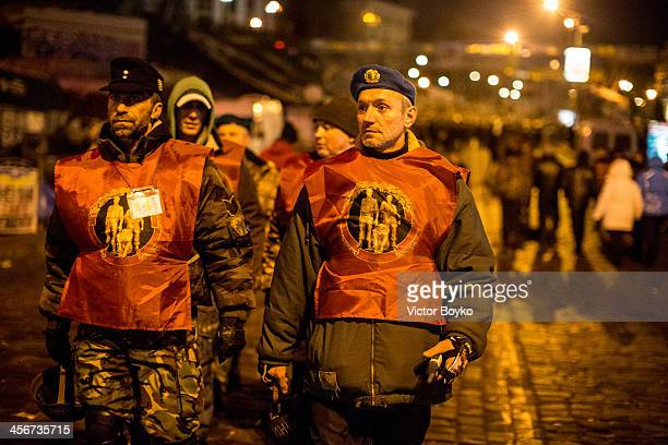 Protesters in military uniform patrol Maidan Square on December 14 2013 in Kiev Ukraine Antigovernment protests began three weeks ago when Ukrainian...