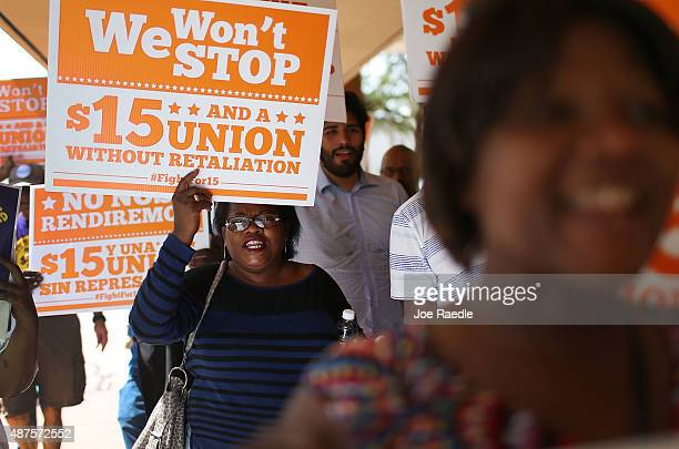 Protesters in support of a $15 an hour minimum wage march together on September 10 2015 in Fort Lauderdale Florida Seattle San Francisco and Los...