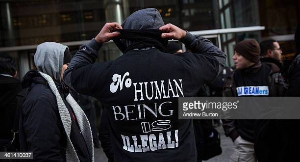 Protesters in support of the Dream Act hold a rally outside New York Governor Andrew Cuomo's New York City office on January 8 2014 in New York City...
