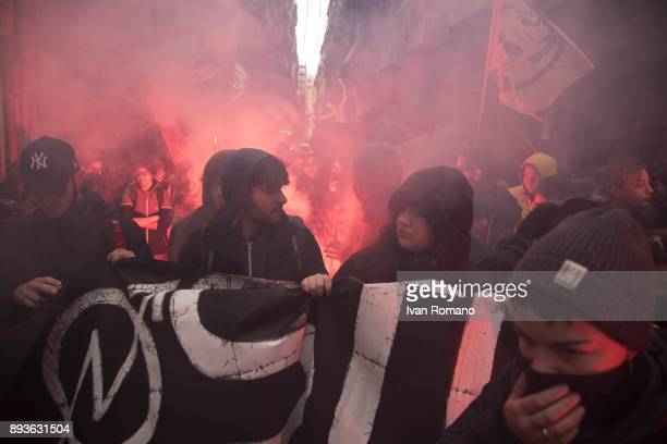 Protesters in the march with a flare during the demonstration in the streets of Naples against the schoolwork alternation system wanted by the...