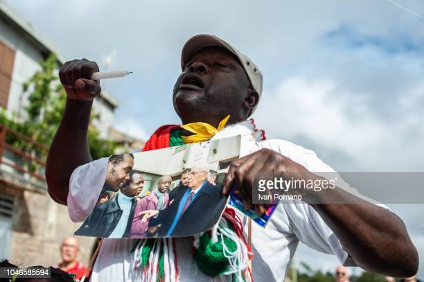 Protesters in the streets of Riace demonstrate against the arrest of Mimmo Lucano on October 6 2018 in Reggio Calabria Italy Domenico 'Mimmo' Lucano...