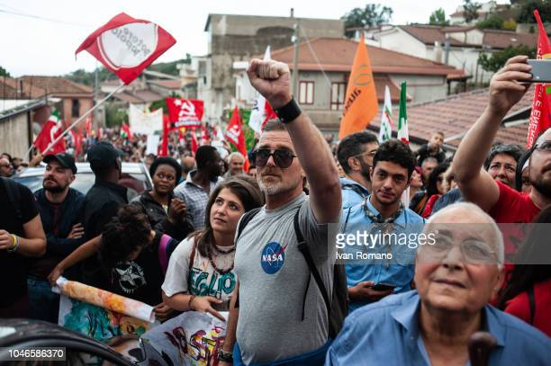 Protesters in the streets of Riace demonstrate against the arrest of Mimmo LucanoDomenico 'Mimmo' Lucano is mayor of Riace a town in the province of...