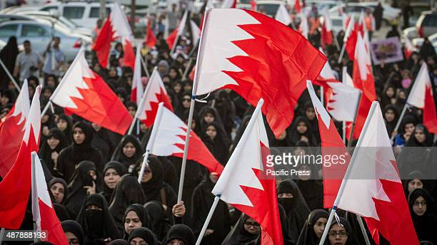 Protesters in the women's side of the march demanding human rights and democracy carrying Bahraini flags in Jidhafs town west of Manama