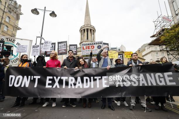 Protesters, including Julian Assange's partner Stella Morris , march behind a banner calling for the release of Wikileaks founder Julian Assange who...