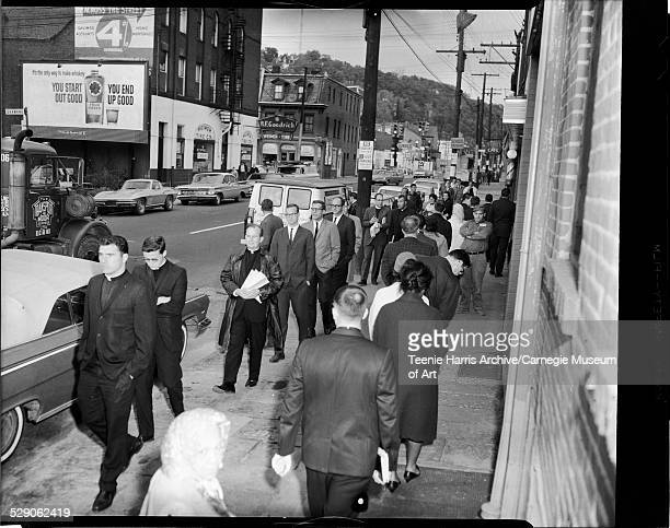 Protesters including Rev Donald McIlvane and other ministers picketing slum housing in front of Rittle Rosfeld Real Estate Company East Street near...