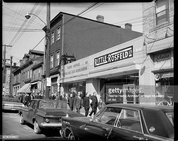Protesters including Rev Donald McIlvane Rev LeRoy Patrick and Bishop Charles Foggie marching against slum housing in front of North Avenue Savings...
