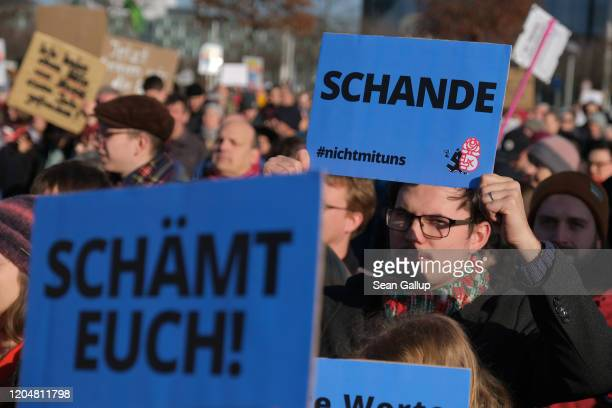 Protesters including some holding signs that read Shame on you and Shame demonstrate outside the Chancellery where the government coalition...