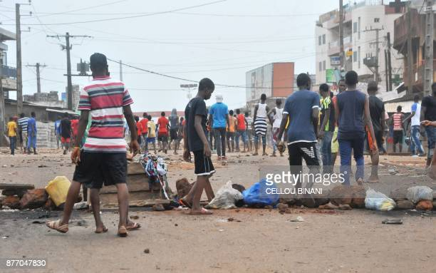 Protesters install barricades on the road during clashes with Guinean riot police officers in a district of Conakry on November 21 2017 Thousands of...