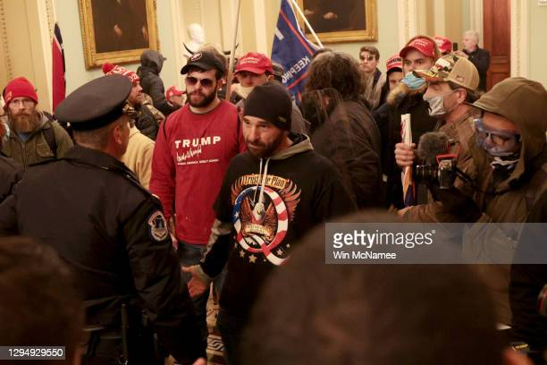 Protesters interact with Capitol Police inside the U.S. Capitol Building on January 06, 2021 in Washington, DC. Congress held a joint session today...
