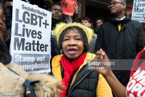 Protesters is seen holding a placard that says LGBT lives matter stamp out homophobia during the Protest condemning the new antiLGBTIQ laws brought...