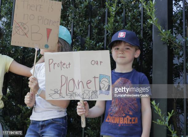 Protesters join a climate related FridaysForFuture protest in front of the UN Headquarters in New York City New York August 30 2019