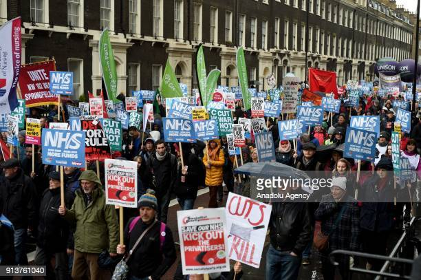 Protesters join a march to Downing Street organised by Health Campaigns Together and the People's Assembly to draw attention to the ongoing crisis in...