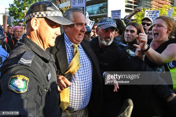 Protesters jostle people attending a Liberal Party fundraiser in Sydney on November 10 as they call on the ruling Liberal coalition government to...