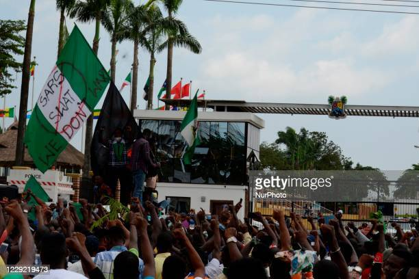 Protesters jubilate as military men dispatched to disperse them in Alausa, Ikeja, Lagos, Nigeria exchange knuckles and take selfie with the...