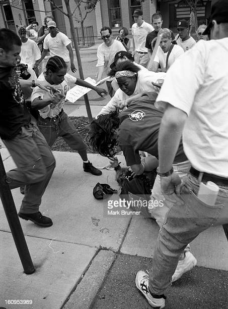 CONTENT] Protesters kick and punch the man down he was saved by the woman in the white usa sweatshirt June 22 1996 A dozen members of a selfanointed...