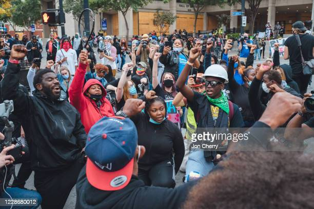 Protesters kneel and raise their fists in the road near Jefferson Square Park on September 23, 2020 in Louisville, Kentucky. Protesters took to...