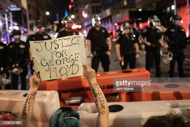 Protesters kneel in front of New York City Police during a march to honor George Floyd near Union Square on May 31 2020 in New York City Protesters...