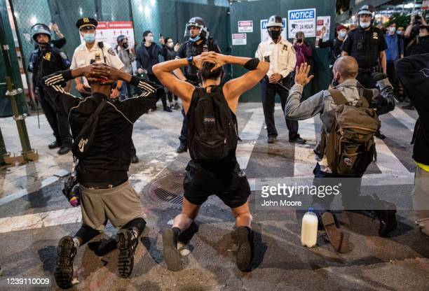 Protesters kneel in front of New York Police during a march to honor George Floyd in Manhattan on May 31 2020 in New York City Protesters...