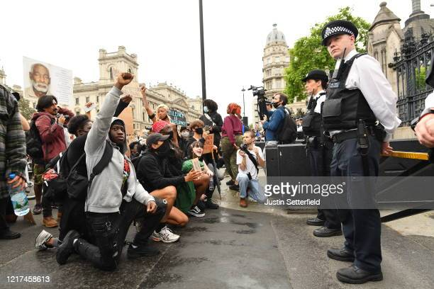 Protesters kneel in front of police during a Black Lives Matter protest in Hyde Park on June 3 2020 in London United Kingdom The death of an...