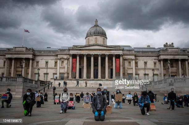 Protesters kneel in Trafalgar Square during a Black Lives Matter demonstration on June 05 2020 in London England The death of an AfricanAmerican man...