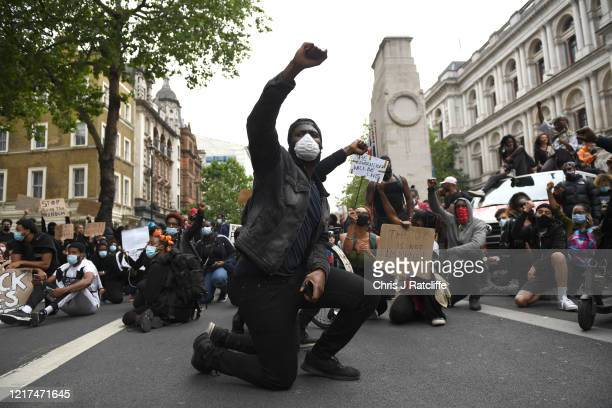 Protesters kneel on the ground during a Black Lives Matter demonstration on Whitehall on June 3 2020 in London United Kingdom The death of an...