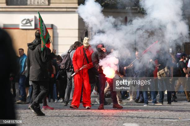 Protesters known as quotblack blocquot attend a oneday nationwide strike over President Emmanuel Macron's policies on October 9 2018 in Paris