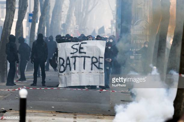 Protesters known as quotblack blocquot walk with a banner reading in French quotto fightquot during a demonstration on April 19 2018 in Paris as part...