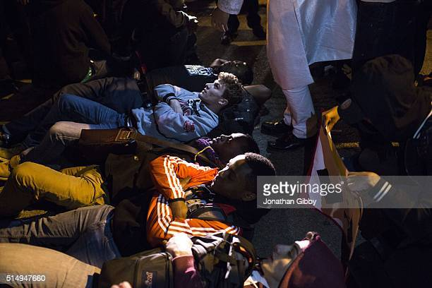 Protesters lay down in the path of a car attempting to exist the University of Illinois at Chicago Pavilion where Republican presidential candidate...