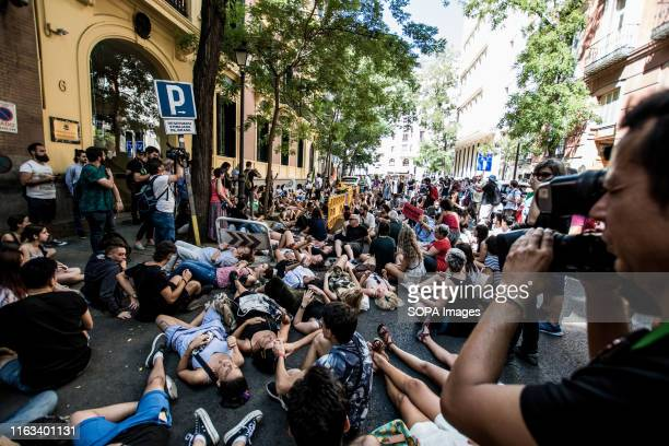 Protesters lay in the street during the demonstration Protesters blocked the street in front of the Brazilian Embassy in an Extinction Rebellion...